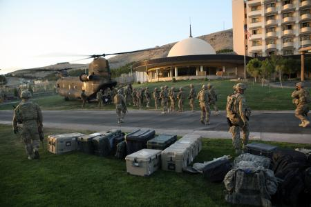 U.S. Soldiers with Delta Company, 1st Battalion, 5th Cavalry Regiment, 2nd Brigade Combat Team, 1st Cavalry Division, unload equipment from a CH-47 Chinook helicopter at the U.S Consulate in Herat province, Afghanistan, Sept. 14, 2013. Delta Company collaborated with other security and military forces to ensure security for the members of the U.S. Consulate after an enemy attack. (U.S. Army photo by Spc. Ryan D. Green/Released)