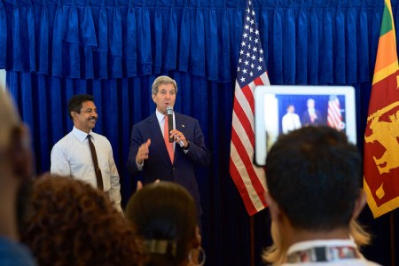 Secretary Kerry Salutes Longtime Embassy Sri Lanka Worker During Employee Meet-and-Greet in Colombo  U.S. Secretary of State John Kerry salutes a longtime Embassy employee who has worked on behalf of the United States for over 30 years as he addressed employees and family members from U.S. Embassy Sri Lanka on May 3, 2015, in Colombo, Sri Lanka. [State Department Photo/Public Domain]