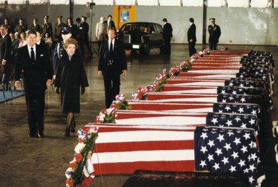 President Ronald Reagan and First Lady Nancy Reagan pay their respects and tribute to the 13 American civilian and 4 U.S. military personnel victims of the embassy bombing.