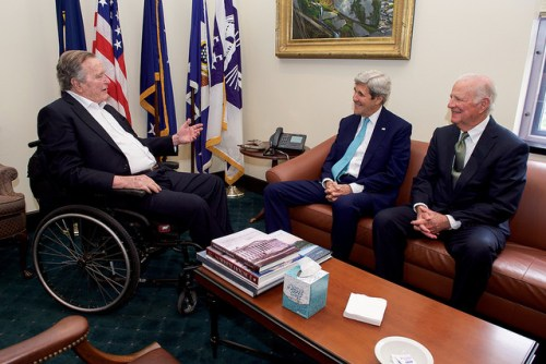 Former President George H.W. Bush chats with U.S. Secretary of State John Kerry and former Secretary of State James A. Baker III in Baker's private office at Rice University's Baker Institute in Houston, Texas, after Secretary Kerry arrived on April 26, 2016, to deliver a speech at Secretary Baker's namesake institution about religion and foreign policy. [State Department photo/ Public Domain]