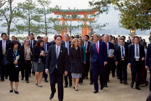 Japanese Foreign Minister Kishida Leads Secretary Kerry on a Walking Tour of the walking tour of the Itsukishima Shrine Japanese Foreign Minister Fumio Kishida leads U.S. Secretary of State John Kerry, U.S. Ambassador to Japan Caroline Kennedy, and other officials on April 10, 2016, during a walking tour of the Itsukishima Shrine off Hiroshima, Japan, following the first round of discussions in the G7 Ministerial Meetings. [State Department Photo/Public Domain]