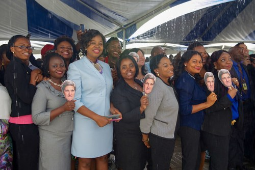 Staffers from U.S. Embassy Abuja Carry Signs Bearing the Face of Secretary Kerry Staffers from U.S. Embassy Abuja carry signs bearing the face of U.S. Secretary of State John Kerry before he addresses them and their family members on August 24, 2016, at the U.S. Embassy in Abuja, Nigeria. [State Department Photo/ Public Domain]
