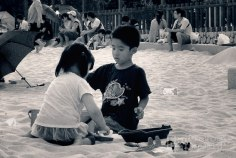Kids playing on the port's sand pit