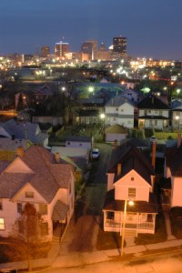 photo of houses with the city in the background.