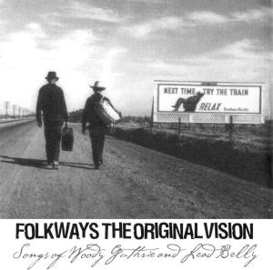 Photo of Woody Guthrie and Led Belly walking down a dirt road