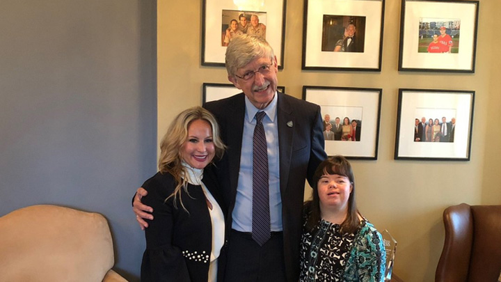 Francis Collins with two members of the National Down Syndrome Society