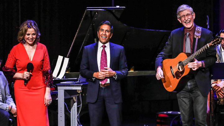 Dr. Francis Collins laughs on stage with Renee Fleming and Dr. Sanjay Gupta