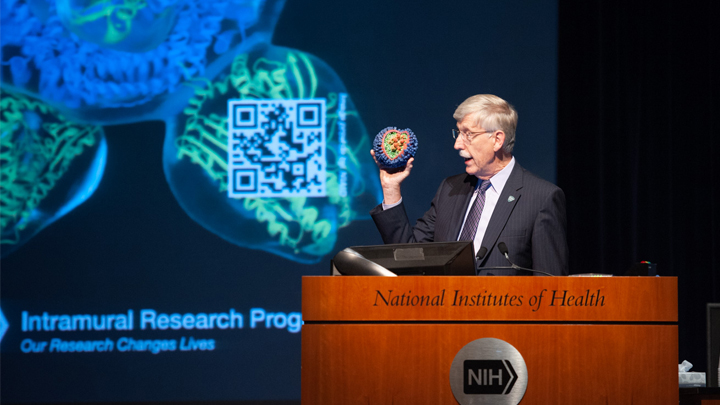 Dr. Collins speaks at a podium at the NIH research festival