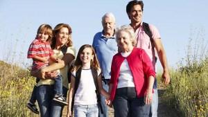 Multigenerational family walks at the beach