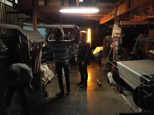 Shadi Chabaan (DP) and Derek Robinson (key grip) discuss the lighting plan.