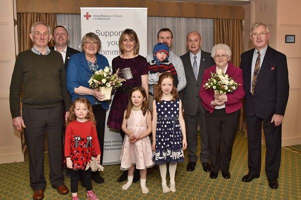 L-R: Larry Roche, Aiden Lonergan, Chairperson Health & Social Care Working Group, Josephine Shine-Roche, Catherine and John Gleeson and their children, Irish Red Cross Chairman Pat Carey, Biddy Gleeson and Seán Gleeson.