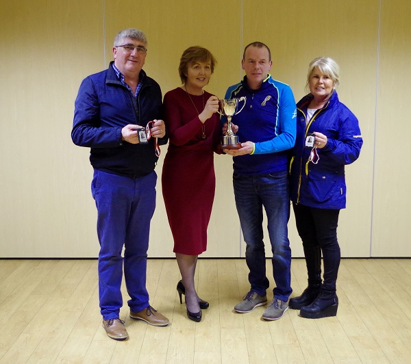 "Christy Slattery (Track-Attack) presenting the ""Scoil Naomh Cualan Get Active"" Cup to Kay Ryan. Also present are Sean and Marie Shanahan of Shanahan's Centra Borrisoleigh (sponsor)"