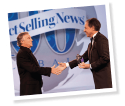 Mark Pentecost (left), Founder and CEO of It Works! Global, accepts the Bravo Momentum Award from DSN Publisher and Editor in Chief John Fleming.