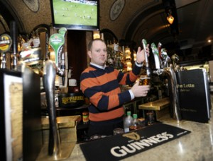 Barman pulling a pint.