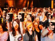 Arthurs Day Pic - People Holding Glasses up to say cheers.