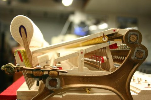 End-on photo of the action of an American Steinway grand piano.