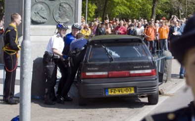 Dutch Policemen inspect the car that slammed into a crowd in Apeldoorn on April 30, 2009. Four people died when a car slammed into a crowd at a festival attended by members of the royal family in the western Dutch city of Apeldoorn, news agency ANP reported. It said witnesses had reported seeing four bodies at the accident scene, where a black car rammed into a monument after mowing down people gathered to watch the annual royal procession. AFP PHOTO / ANP - LEX LIESHOUT netherlands out - belgium out (Photo credit should read Lex Lieshout/AFP/Getty Images)