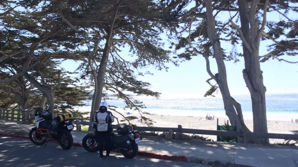 View of or KTM 1090 adventure R and Honda Rebel 500 in front of a white sandy beach in Carmel, California