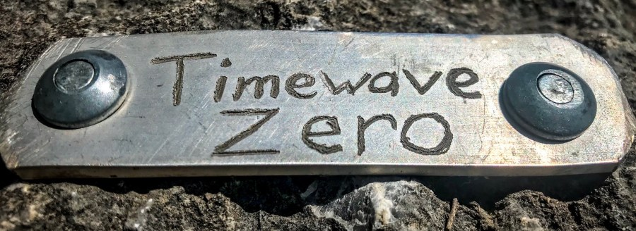 a plaque rivited to the wall that states time wave zero