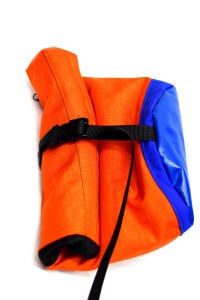 Rolled up boulder bag, clipped with a plastic buckle