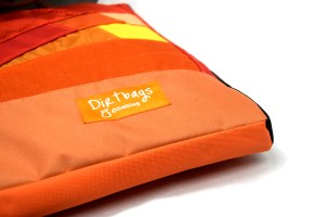 Close up view of the sit start boulder pad, 5cm deep, orange with a dirtbags label.