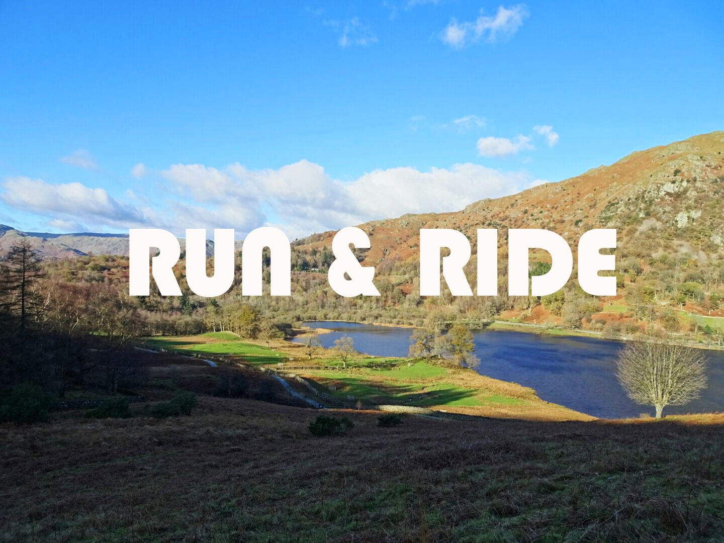White lettering ' run and ride' in front of Lake District landscape