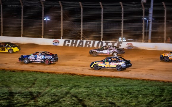Several 4 cylinders on a dirt track.