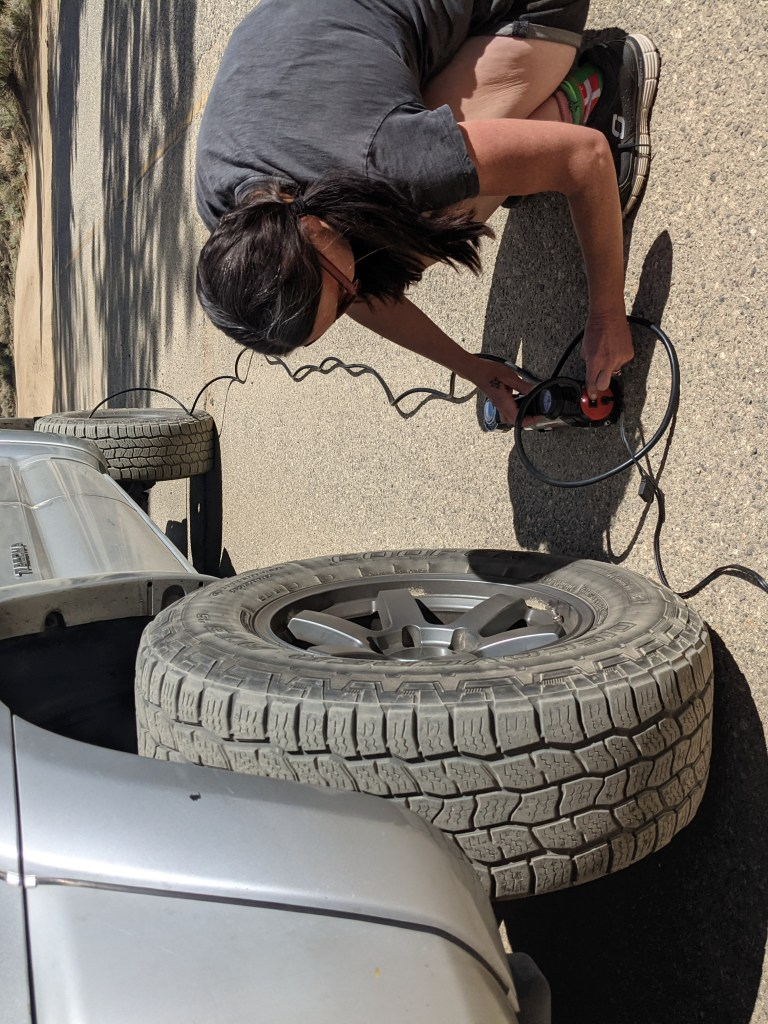 wife airing up tires