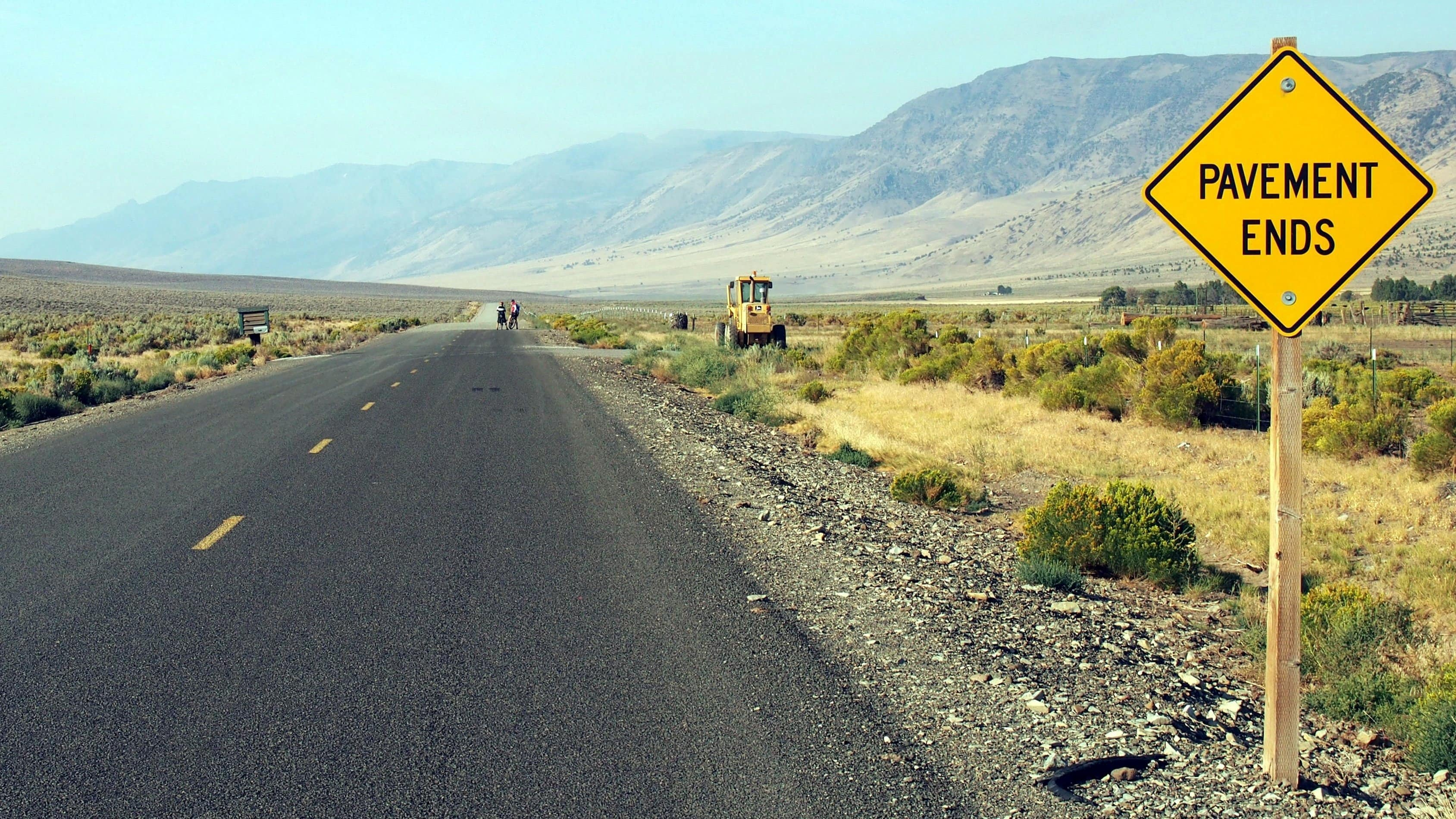 Fields Denio road, paved. Steens Mountain in background.