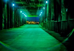 a shot inside the underpass of the santa monica pier in california