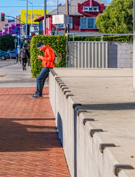 man looking at texts on his phone