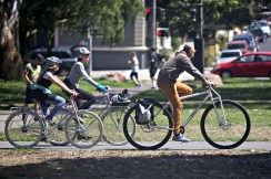 """6'6"""" DirtySixer founder riding along with regular sized cyclists in San Francisco."""