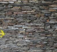 arrow on a brick wall