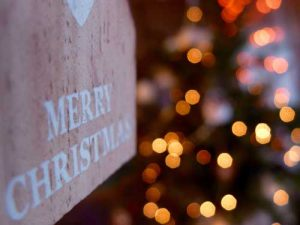 """""""Merry Christmas"""" sign with lights."""