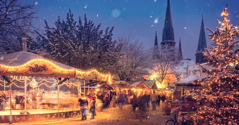 Christmas market at dusk covered in snow