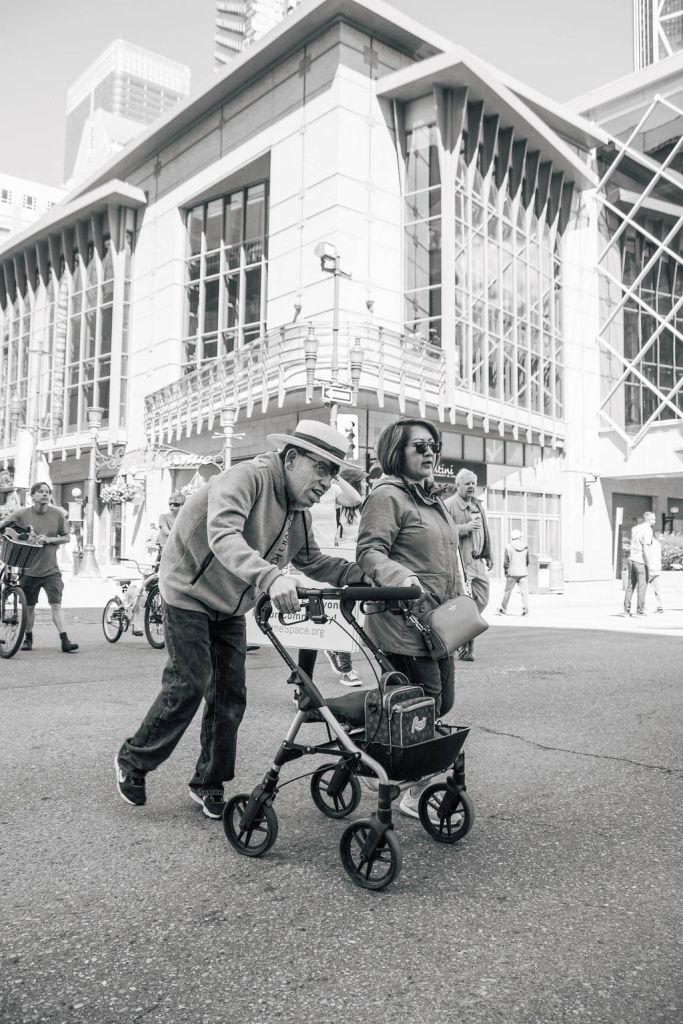 Man and woman. Man has walker