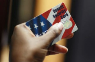 hand holding a benefit security card