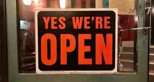 Yes we're open sign on door