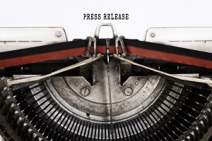 Old fashioned typewriter with page load that says Press Release