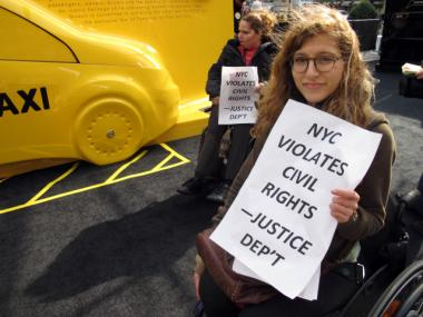 """G.G. Defiebre, 23, has been in a wheelchair for the past two years. She visited the """"Taxi of Tomorrow"""" expo on Thursday, Nov. 3, 2011, to protest its inaccessibility."""