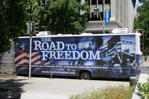 "A large bus that says, ""The Road to Freedom"""