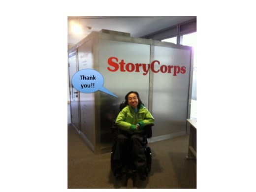 "Asian American woman wearing a green rain jacket in a wheelchair in front of a large cubical recording booth with the word 'StoryCorps' in front. A caption bubble reads, ""Thank you!!"""