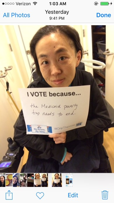 """Screenshot of an iPhone's Photo library with an image of an Asian American woman in a wheelchair holding a white piece of paper that says, """"I Vote because...the Medicaid poverty trap needs to end."""""""
