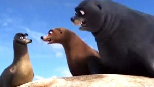 """An animated scene from the Pixar film """"Finding Dory."""" Two large sea lions staring down at another 'goofy' looking sea lion."""