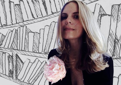 Collage of an Ink pen drawing of many books on a bookshelf and a color photograph of a woman wearing a black blouse with a pink peony pinned on the left lapel. The color photograph is superimposed upon the ink pen drawing.