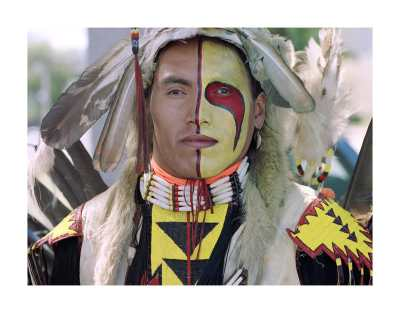 "Title: Kevin Haywahe, Assiniboine First Nation, 1990, pigment print on archival paper. By Jeff Thomas: ""The photo I have attached is from my powwow portrait series ""Strong Hearts."" My aim is to take an iconic image of Indianness and invite each dancer to return the tourist gaze and open a conversation."""