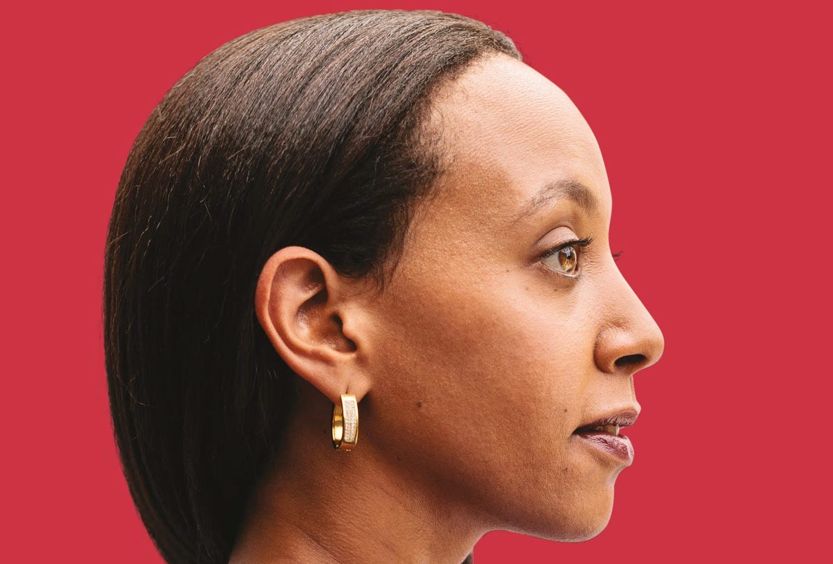 "The book cover shows Haben in profile, confidently facing forward in a blue dress. The background is a warm red, and white text over the bottom half reads: ""Haben"""