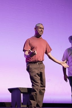 "This is a photo of me performing in my show And He Became Man. A Latino disabled man questions his manhood by looking back at his life recalling major events influencing him, asking, ""What is a man"". Manuel, the main character, takes the audience on his personal journey from the time when his parents migrated into the United States through his break down dealing with his brother's death."