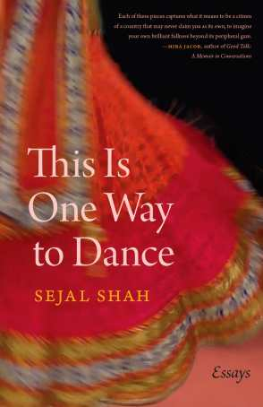 "A still shot taken from a video of the author spinning in a vibrant red-orange colored dress. Only the flare of the dress is visible; the text on the cover: THIS IS ONE WAY TO DANCE (the title) and the author's name, Sejal Shah, are in the middle of the cover on top of the dress image. The subtitle, ""Essays,"" is in the lower right-hand corner in black lettering on a pink background. The top right-hand corner, which is a black background, hosts the cover blurb: ""Each of these pieces captures what it means to be a citizen of a country that may never claim you as its own, to imagine your own brilliant fullness beyond its peripheral gaze."" --Mira Jacob, author of Good Talk: A Memoir in Conversations."