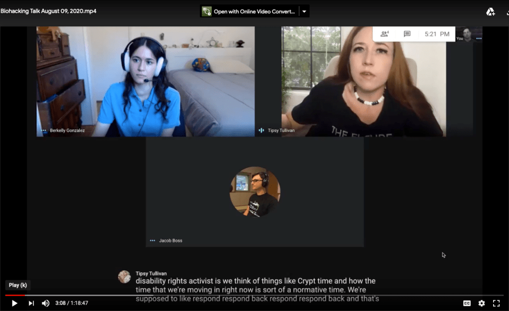 "A screen grab of a Google Meet. Top left square: Berkelly is a woman in her mid 20s with dark brown hair wearing a blue button up short sleeved shirt and a headset with light pink headphone cushions. She is sitting at a desk in a bedroom and is taking notes throughout the video. Top right square: The Cyborg Jillian Weise is a white woman with reddish-brown long hair sitting on a beige chair. She is wearing a black short sleeve tee-shirt that reads ""The Future Is Accessible."" Behind her, there is a window with the blinds open and green leaves outside. Middle square: Jacob Boss's avatar. He is a white man with wavy medium-length brown hair. The caption reads: ""we think of things like Crypt time."" The Google AI has mistranslated ""crip time"" for ""Crypt time."""